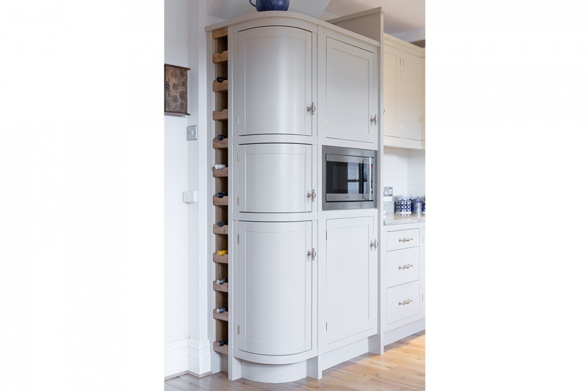 Curved kitchen cupboards. Full height wine rack. Cornwall