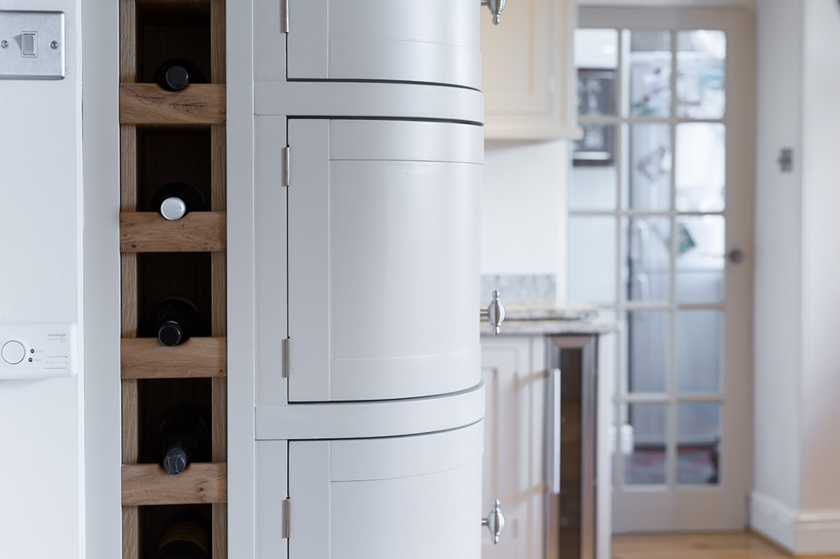 Hand crafted Shaker style kitchen featuring curved doors and full height wine rack. Falmouth, Cornwall