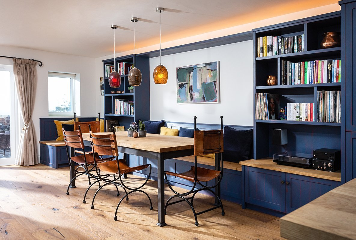 Built-in-bench-dining-table-shelving-and-stoarge-Samule-F-Walsh-Furniture-Kitchens-Interiors-Cornwall